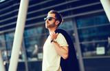 fashionable man in urban setting - 143453085