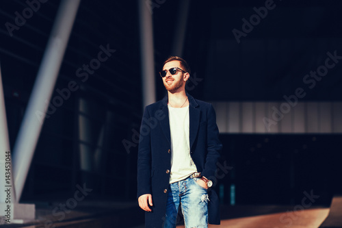 Poster portrait of a handsome man wearing jacket and sunglasses
