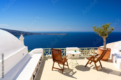 terrace with view on aegean sea in Oia village Santorini island, Cyclades, Greec