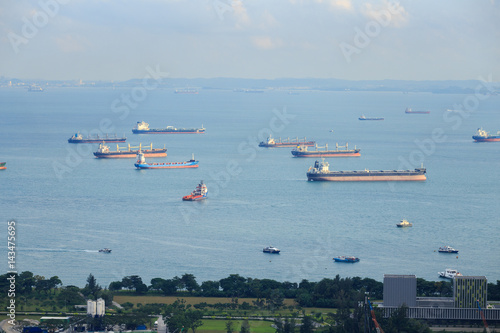 Boats waiting in front of Singapore Harbor in south east asia Poster