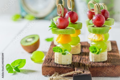 Homemade finger food with various fruits and mint for snack