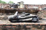 Broken Ancient buddha statue at Wat Mahathat temple complex in Ayutthaya.Thailand