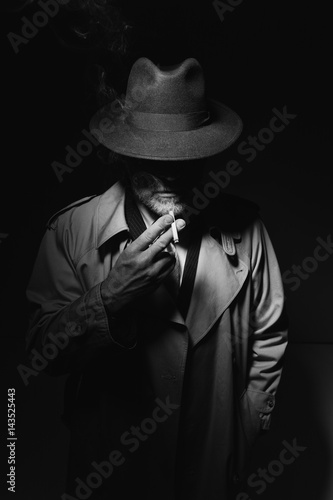 Noir film character smoking a cigarette