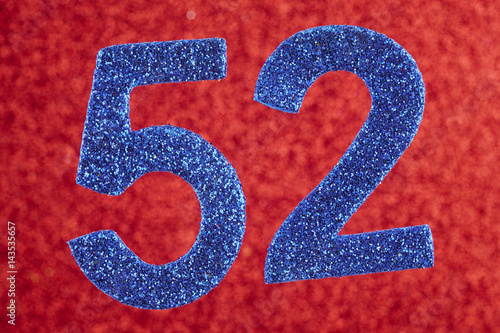 Poster Number fifty-two blue over a red background. Anniversary.