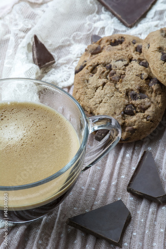 Poster One glass cup of espresso with cookies with dark chocolate on the pink backgroun