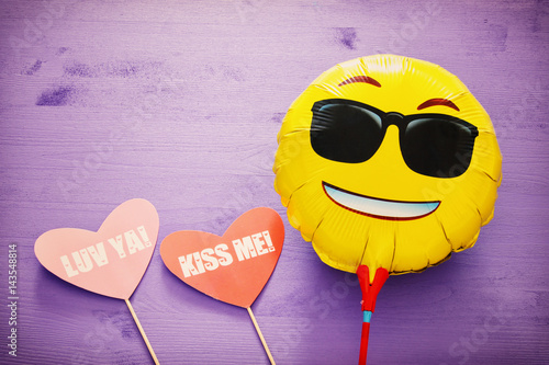 cute smiling emoticon wearing black sunglasses, emoji concept Poster