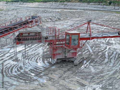 view in a quarry mine with excavator