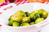 Boiled brussels sprouts in white bowl