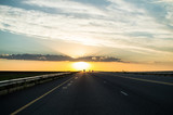 Driving into the Sunset on a Highway, Free State, South Africa