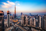 Spectacular aerial view of Dubai, UAE, at sunset. Colourful skyline of a big modern city. Travel background.
