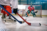 Fototapety ice hockey player in action kicking with stick .