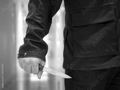 Keuken foto achterwand Vlinders in Grunge Balck and white Killer man is attacking with knife.