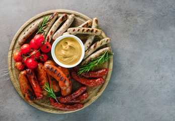 Grilled sausages on a round board