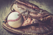 Old worn used leather baseball sport glove over aged