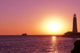 Lighthouse on the black sea. Crimea. Sunset
