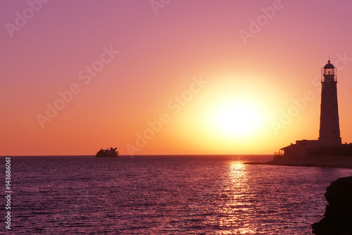 Aluminium Candy roze Lighthouse on the black sea. Crimea. Sunset