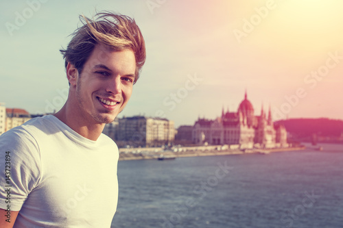 Young blonde man with Budapest background vintage style Poster