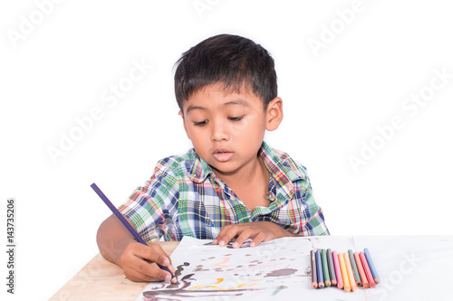 Cute little boy painting on book drawing
