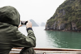 Man photographed from the boat in Ha Long Bay in Vietnam