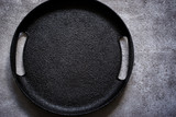 Empty rustic black cast iron plate On a concrete background. Top view with copy space - 143772248