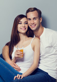 Couple with glass of orange juice and fruits