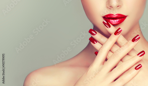 Foto op Canvas Manicure Beautiful girl showing red manicure nails . makeup and cosmetics
