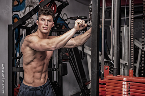 Man In The Gym Exercising. Athletic sport lifestyle