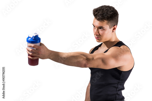 Muscular young male bodybuilder holding protein shake bottle, drinking Poster