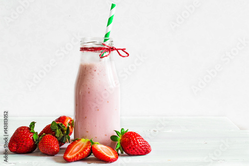 Fotobehang Milkshake Strawberry smoothie or milkshake in a bottle with straw