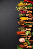 Background with various spices on black slate. Top view - 143821074
