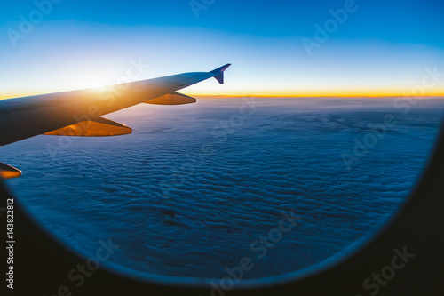 Aerial view from airplane window at sunset - 143822812