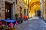Medieval narrow street in Siena, Tuscany, Italy