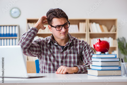 Student breaking piggybank to pay for tuition fees Poster