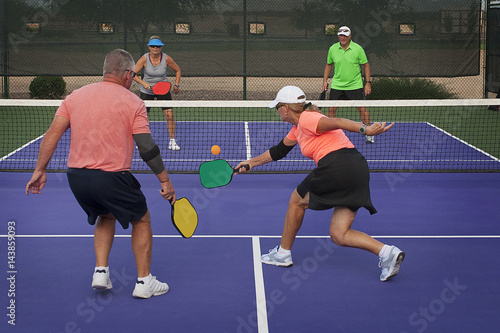 Fotobehang Tennis Pickleball Action - Mixed Doubles Play