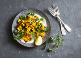 Roasted turmeric cauliflower with greek yogurt dressing. Delicious healthy snack on a dark background, top view - 143860627