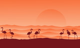 desert scenery with flamingo silhouettes