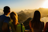 Tourists watching from the Sugarloaf mountain over Rio to Corcovado on a beautiful evening