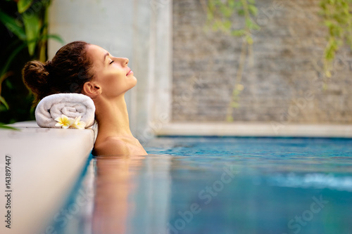 Beauty and body care. Sensual young woman relaxing in outdoor spa swimming pool. © luengo_ua