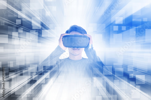Asian man wearing virtual reality glasses