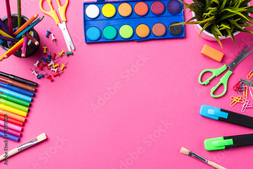 School or art supplies on pink background