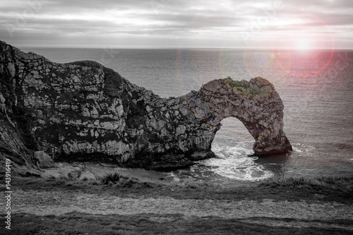 Poster Durdle door at sunrise.
