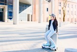 10 years old girl with self balancing electric skateboard