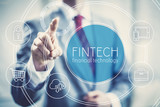 Future of financial technology concept businessman selecting fintech word