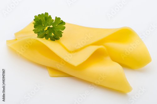 Cheese slices on white background cutout.