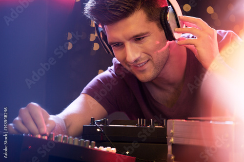 Man mixing music on turntable Poster
