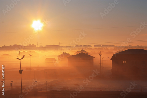 cityscape with fog at dawn
