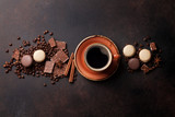 Fototapety Coffee cup, chocolate and macaroons on old kitchen table