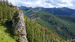 Mountain landscape with a stone cliff and forest. View from Mount Nosal, Tatry, Poland