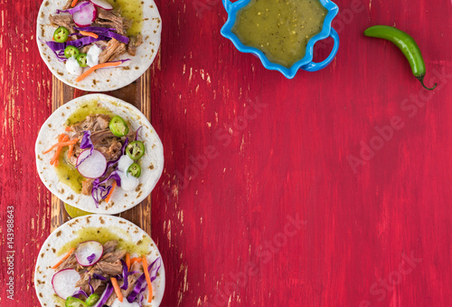 Tuinposter Hot chili peppers Pork verde tacos. Copy space.