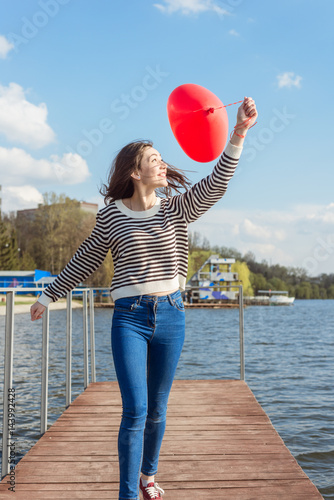 Poster Portrait pretty happy smiling woman with air balloons heart shaped park outdoor